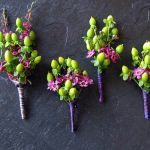 green and purple boutonnieres