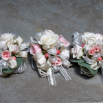 pinky peach pearl wrist corsages   photo by Henry Ninde Photography