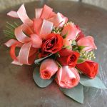 pink, red and coral corsage