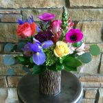vibrant spring in a hickory vase