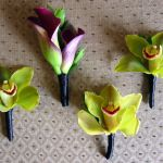 purple and green boutonnieres