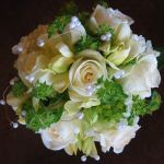 white rose and daffodil with pearl garland bridal bouquet