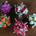 spray rose and orchid wrist corsages