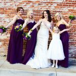 purple and blue bridal bouquet and bridesmaids