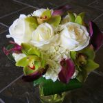 white rose, green cymbidium orchid, purple mini calla lily bouquet