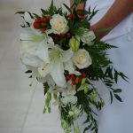 White lily red rose and white orchid cascade bridal bouquet