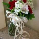 red and white toss bouquet