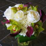 white rose, hydrangea, purple mini calla lily and green cymbidium bridal bouquet
